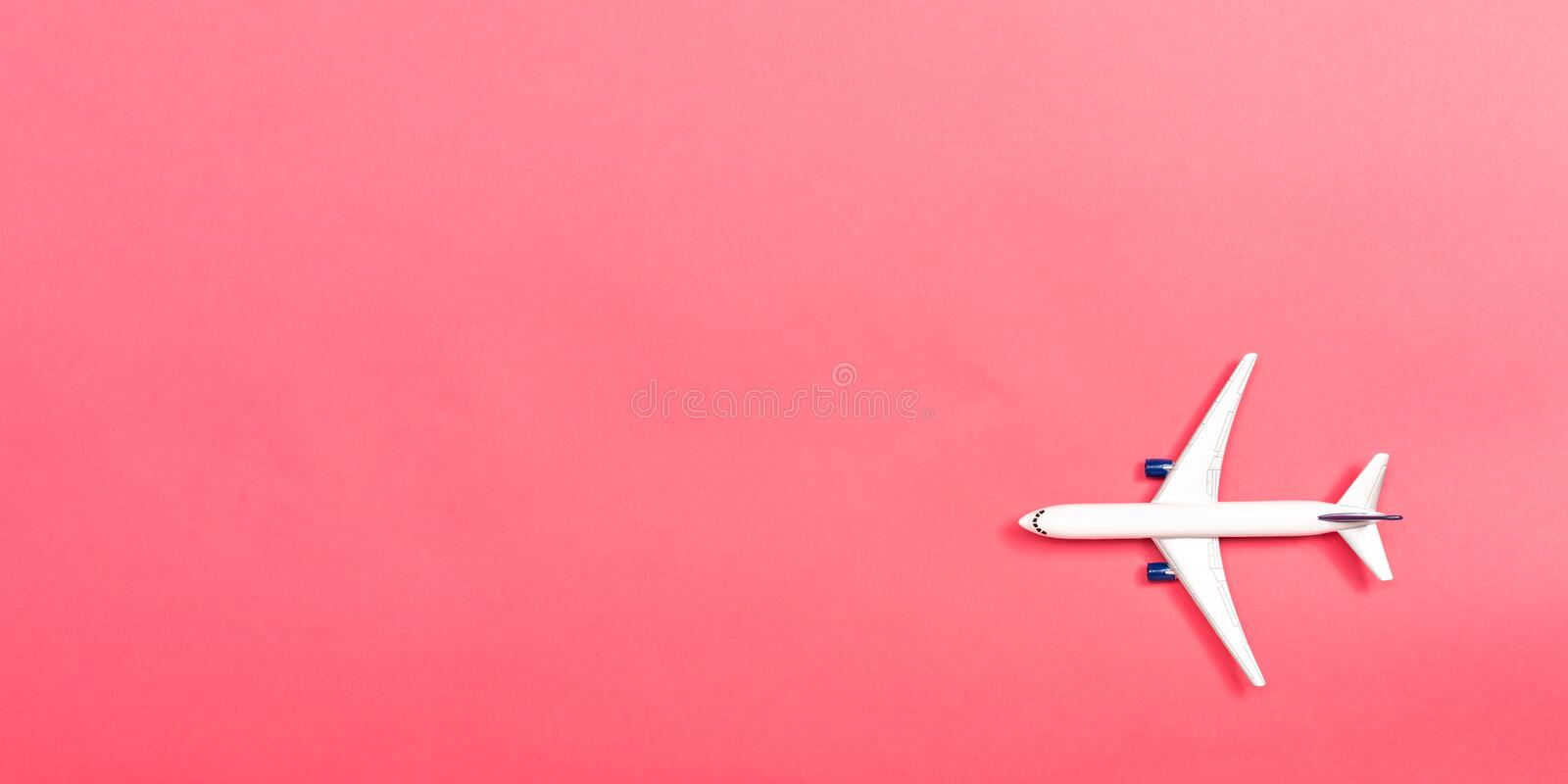 A toy airplane. On a pink paper background royalty free stock photos