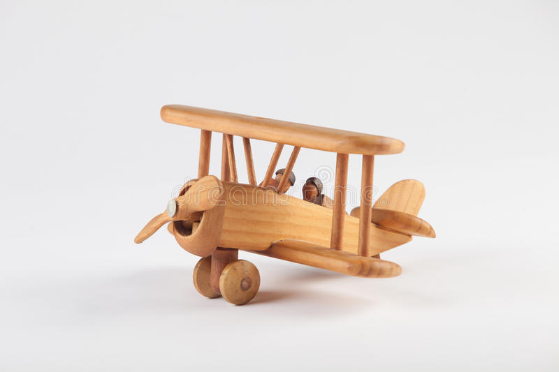 Toy airplane. Toy wooden airplane on white background stock photos