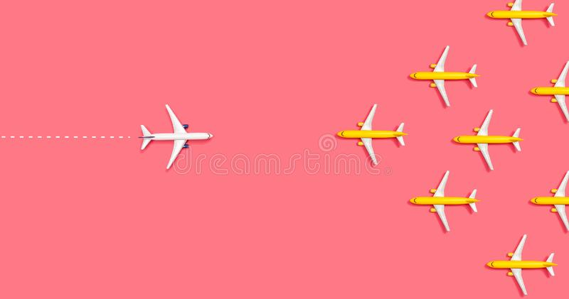 Toy airplanes opposing each other. Overhead view flat lay royalty free stock photo
