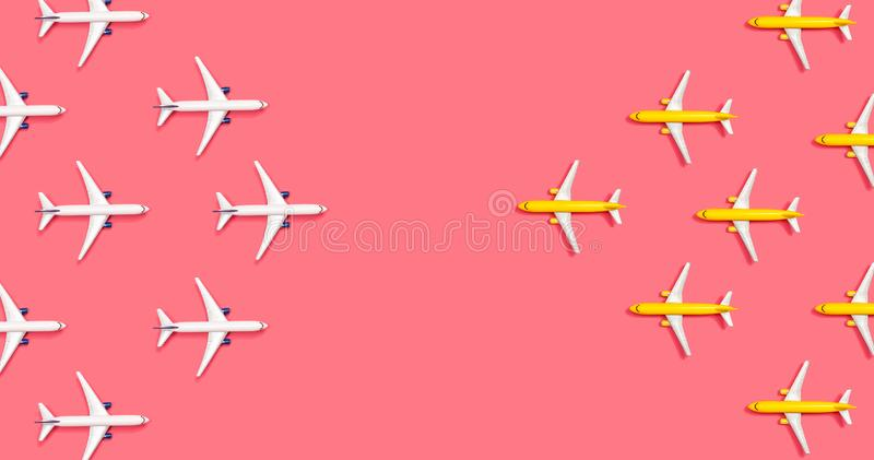 Toy airplanes opposing each other. Overhead view flat lay royalty free stock photography