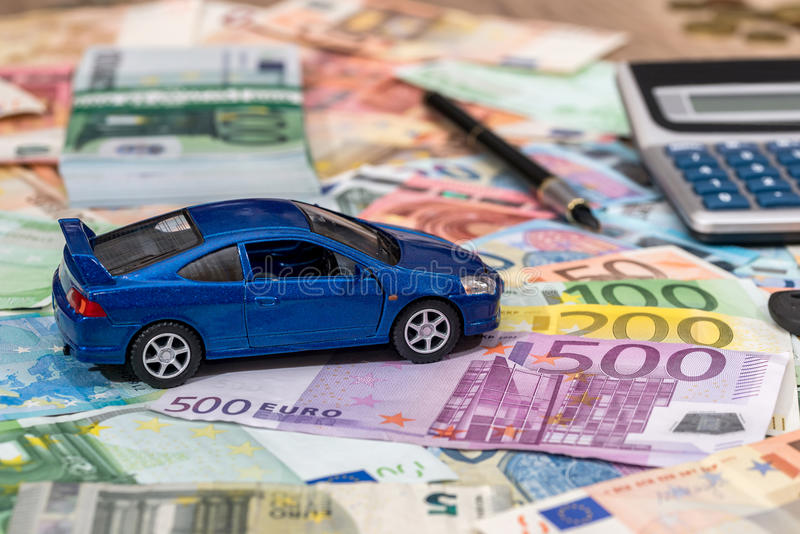 Toy automobile with euro money. Car and money concept - toy automobile with euro money stock photography