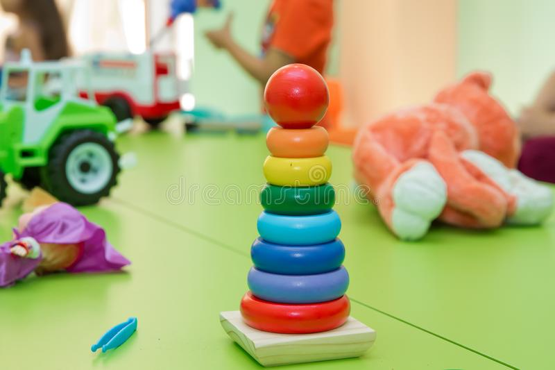 Toy for babies and toddlers to joyfully learn mechanical skills and colors . Educational toys for toddlers, gripping rings,. Educational toys for toddlers stock photography