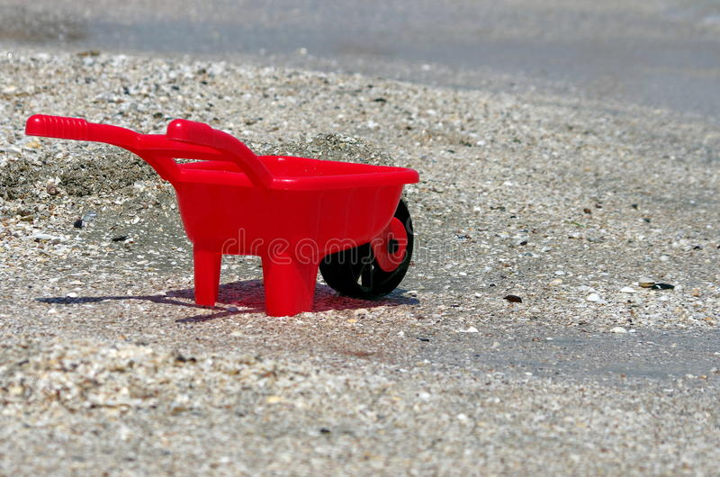 Seascape with toy on the beach. Summer, sun, sea, beach, fun, holiday. Seascape with plastic toy on the beach. Summer, sun, sea, beach, fun, holiday royalty free stock photography
