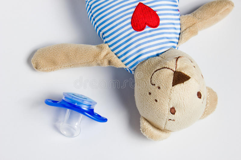 Toy Bear and dummy lying on a white background. royalty free stock photo