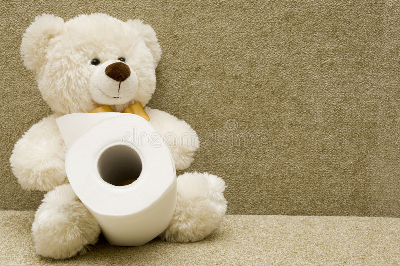 Toy bear with toilet paper stock images