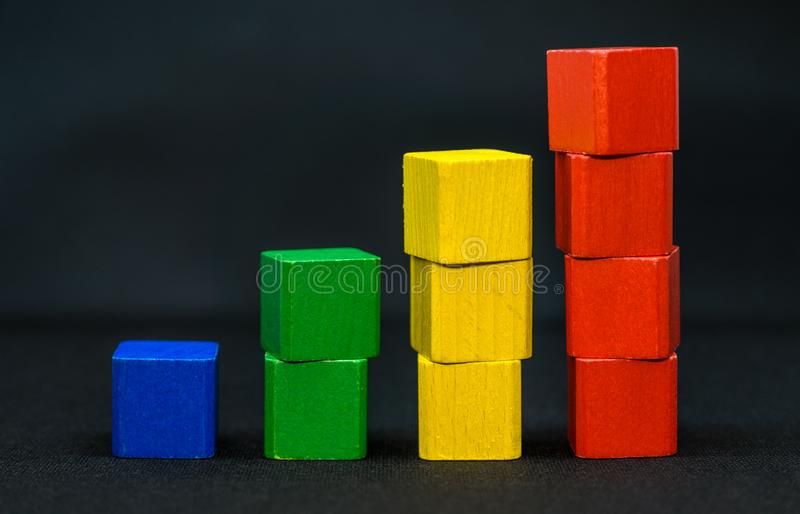Toy blocks or bricks - yellow, green, red, blue - white background stock photo