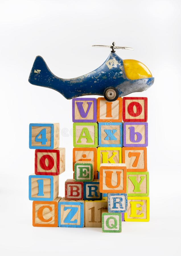 Toy Blocks and Planes. Toy letter blocks and a old toy helicopter royalty free stock images