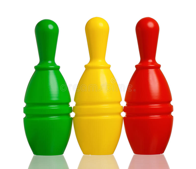 Toy bowling. Colorful plastic skittles of toy bowling isolated on a white background stock photography