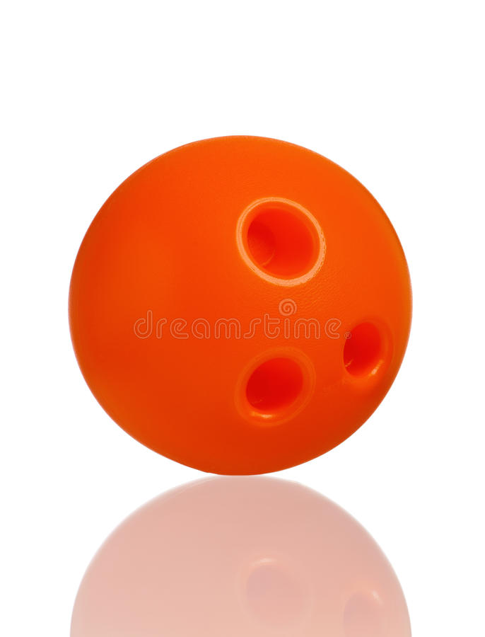 Toy bowling. Single plastic orange ball of toy bowling isolated on a white background royalty free stock photo
