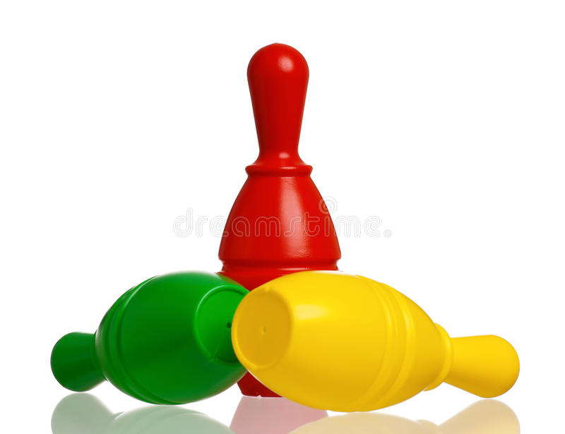 Toy bowling. Colorful plastic skittles of toy bowling isolated on a white background royalty free stock image