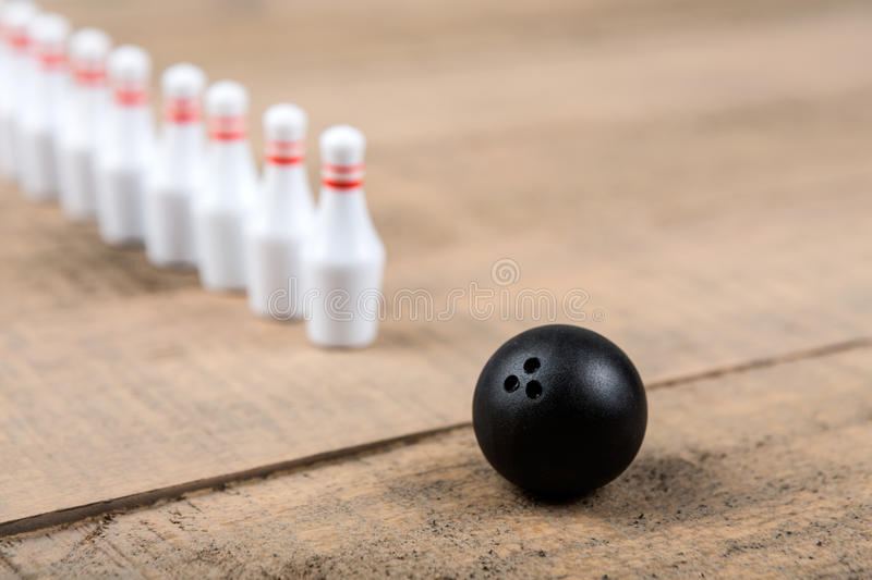 Toy bowling ball and pins. On a wood background royalty free stock photography