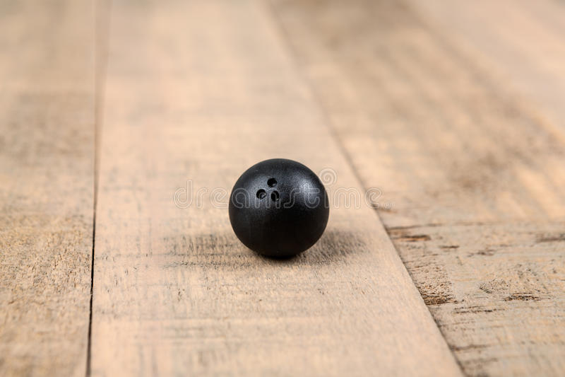 Toy bowling ball. On a wood background stock images