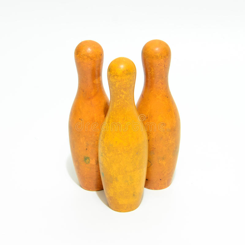 Toy Bowling pins. Three yellow Toy Bowling pins stock images