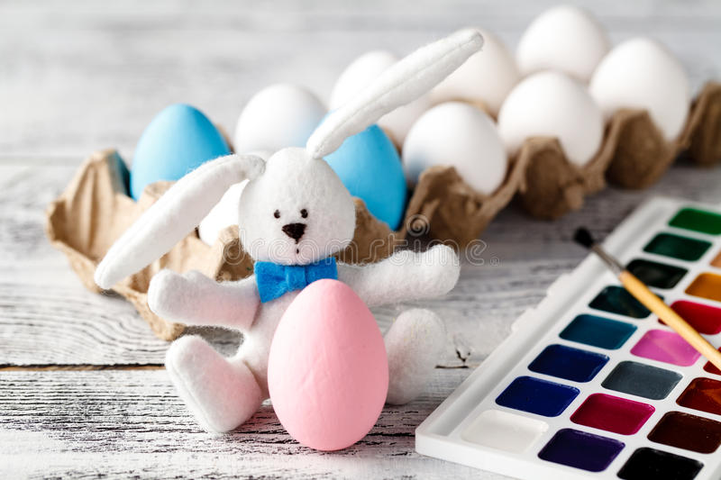 Toy bunny and colorful Easter eggs royalty free stock photo