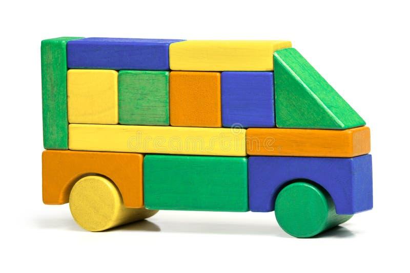 Toy Bus enkel figursåg för barn, färgar träbilen royaltyfri foto