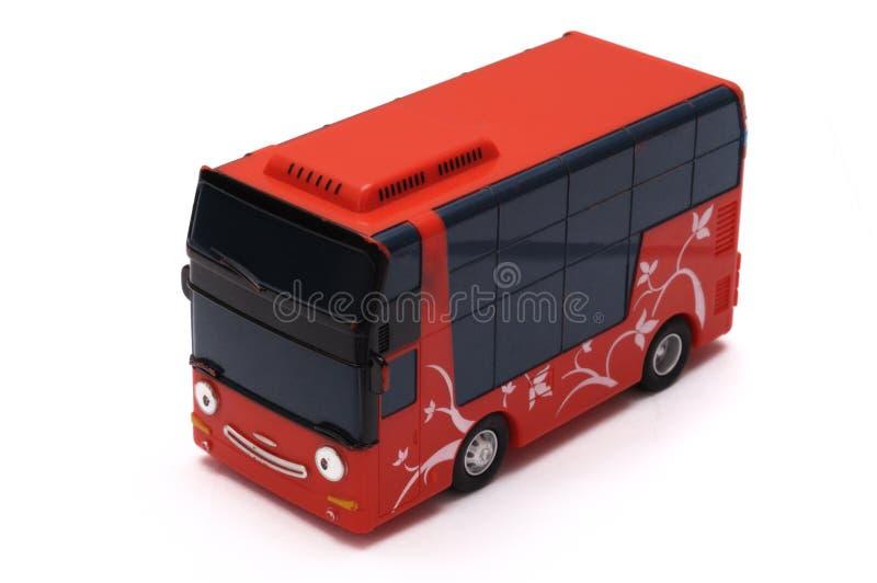Toy Bus vermelho com uma cara feliz fotografia de stock royalty free