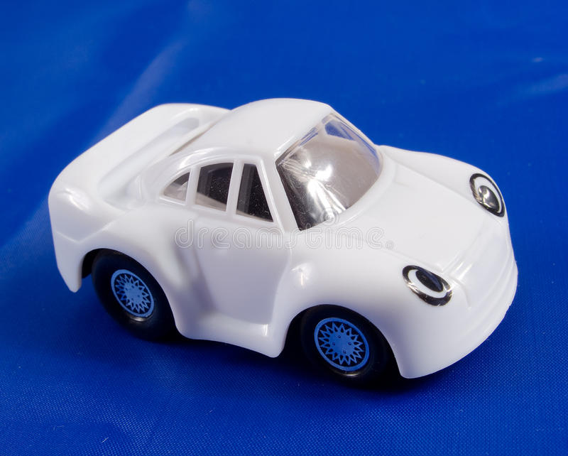 The toy car. On a dark blue background royalty free stock images
