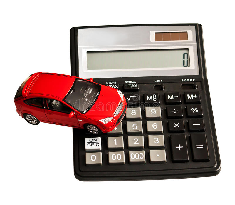 Toy car and calculator. Concept for buying, renting, insurance, fuel, service and repair costs royalty free stock image