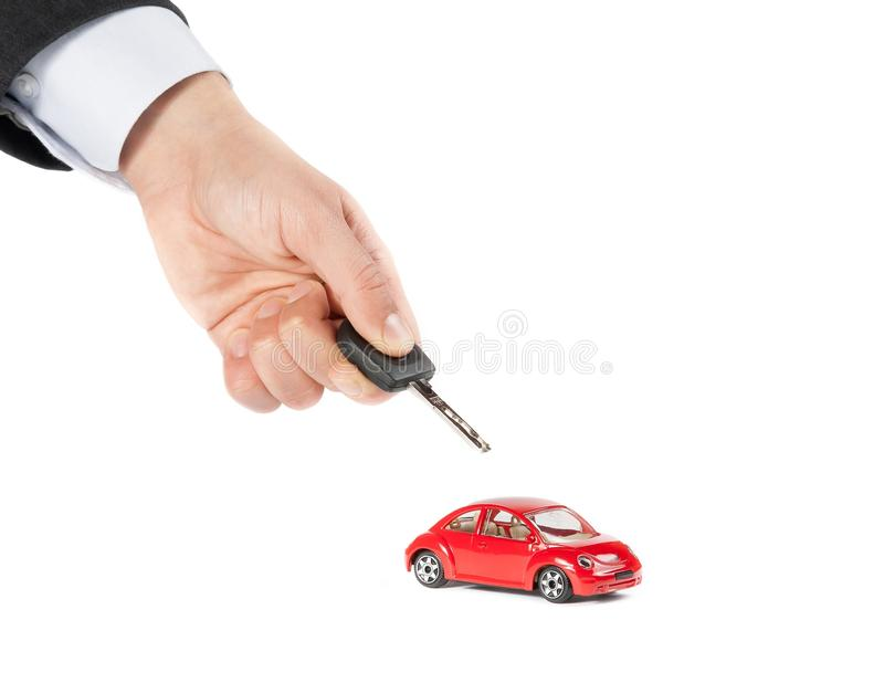 Toy car and car key concept for insurance, buying, renting, fuel or service and repair costs. On white background stock photography