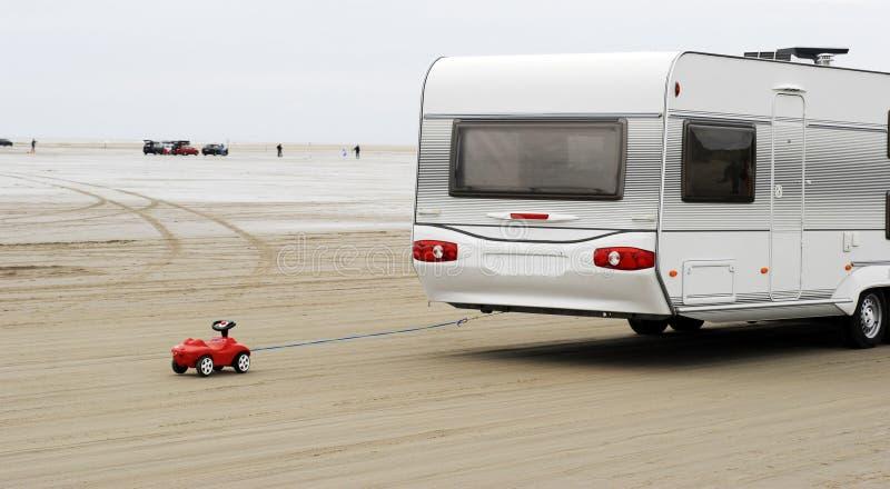 Toy car and caravan royalty free stock photos