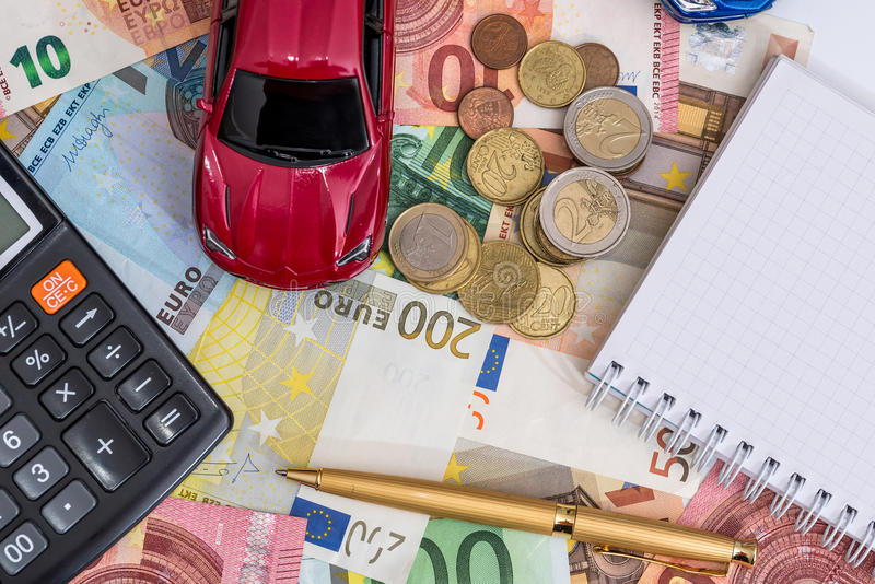 Toy car, euro, calculator. And pen royalty free stock photography