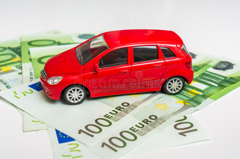 Toy car and euro money - insurance, rent and buying car. Toy car and euro money banknotes on white - insurance, rent and buying car concept stock images