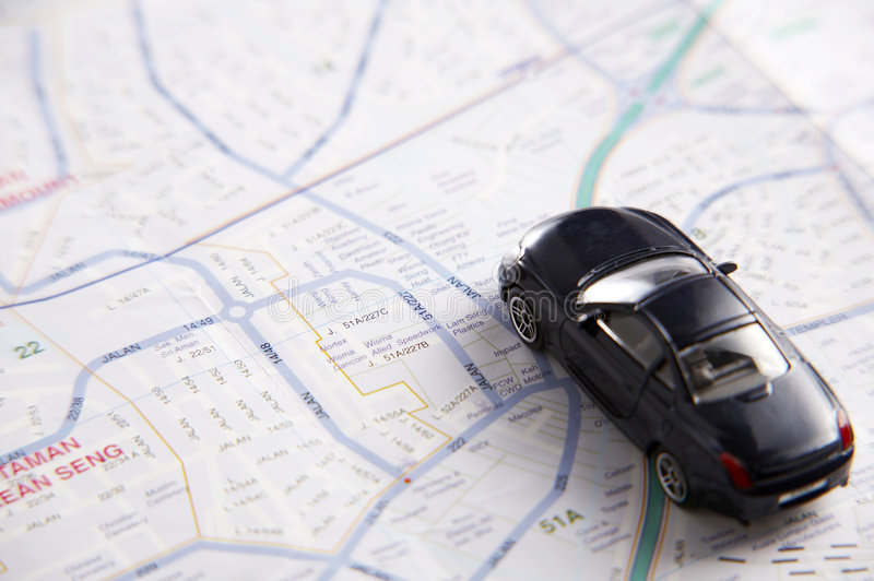 Toy car on the map. Concept shot of car on the map royalty free stock photo