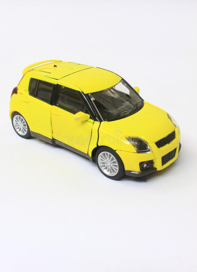 Toy car model. Yellow and small miniature car model stock images