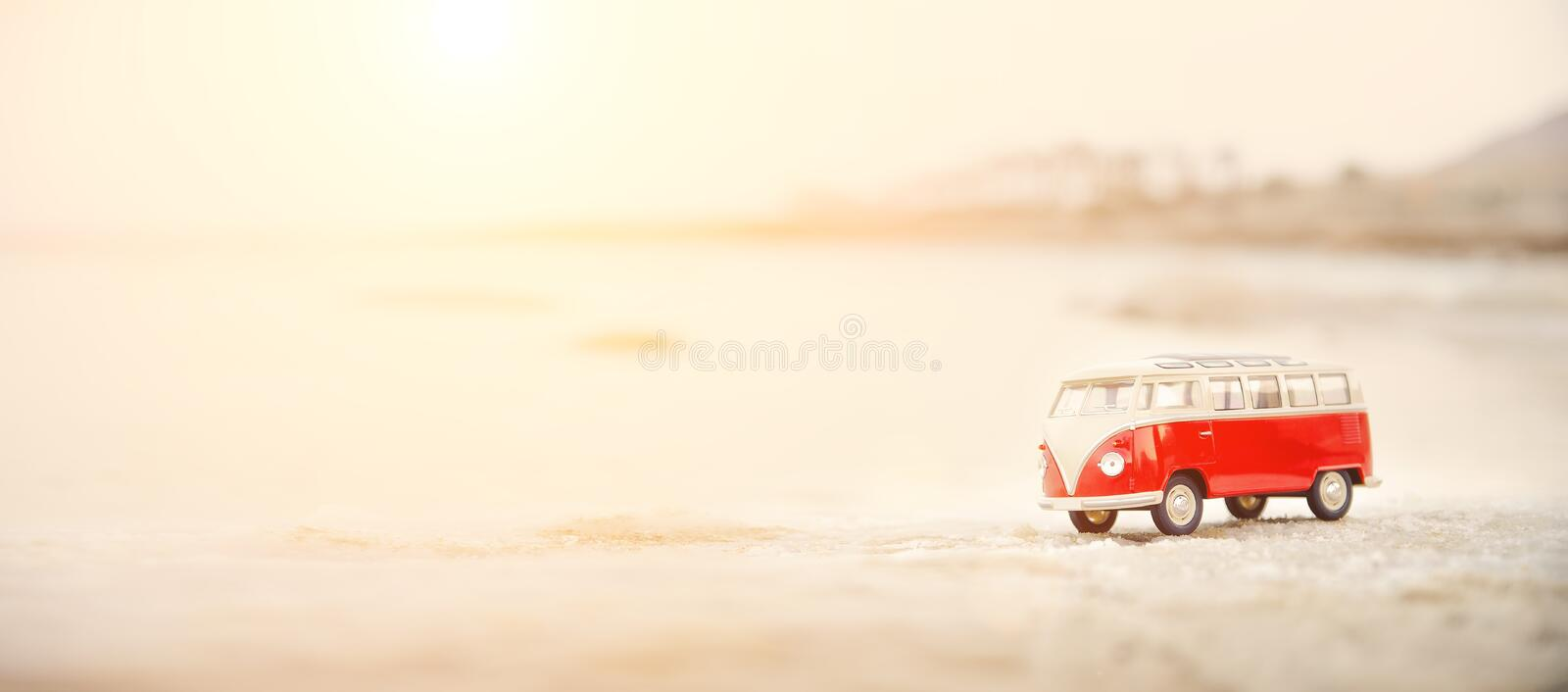 Toy car, model bus park in the sand near sea. Travel concept. Copy space. Sunny day. Toy car, model bus park in the sand near sea. Travel concept. Copy space royalty free stock images