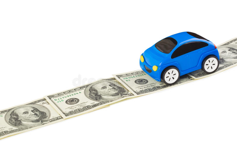 Toy car on money road. Isolated on white background stock photography
