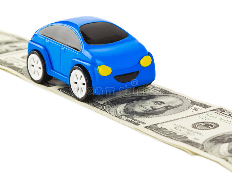 Toy car on money road. Isolated on white background stock photos