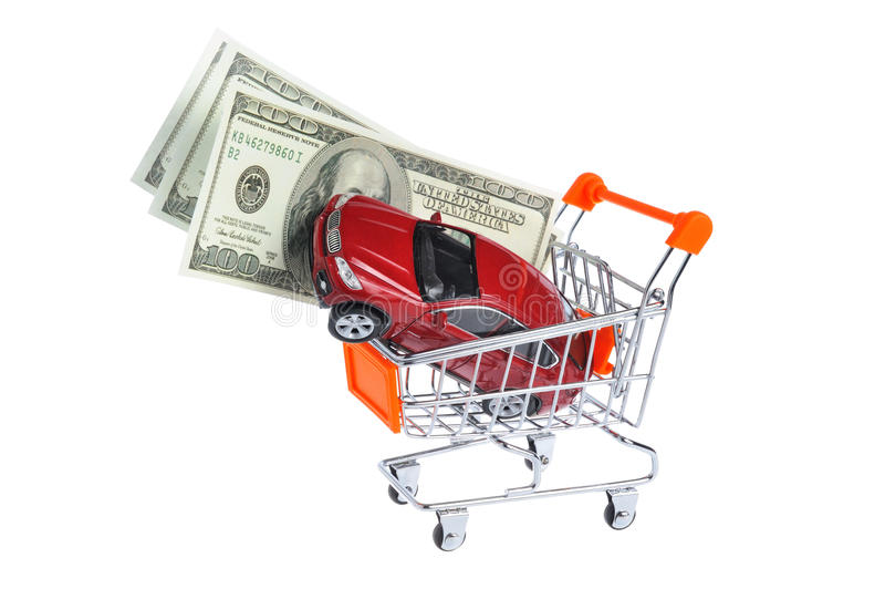Toy car with money in shopping cart isolated on white. Background royalty free stock images
