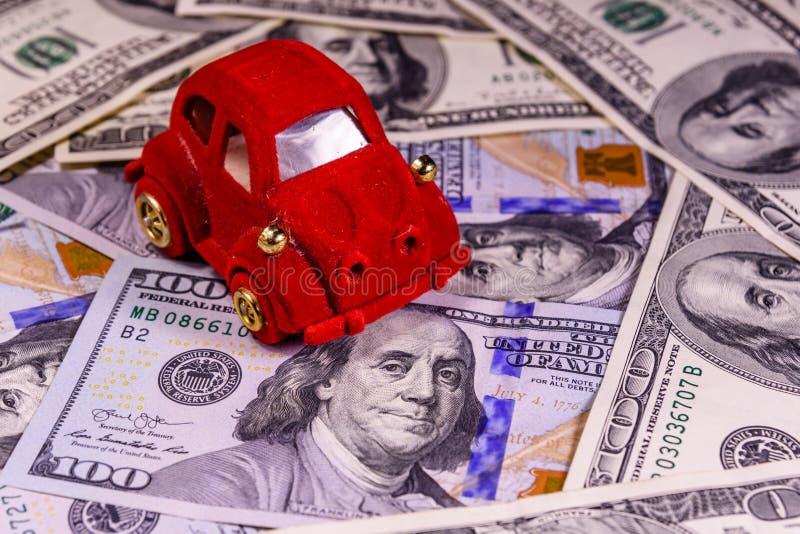 Toy car on a one hundred dollar bills. Toy car on one hundred dollar bills royalty free stock image