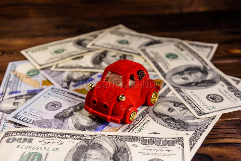 Toy car on a one hundred dollar bills. Toy car on one hundred dollar bills stock photography