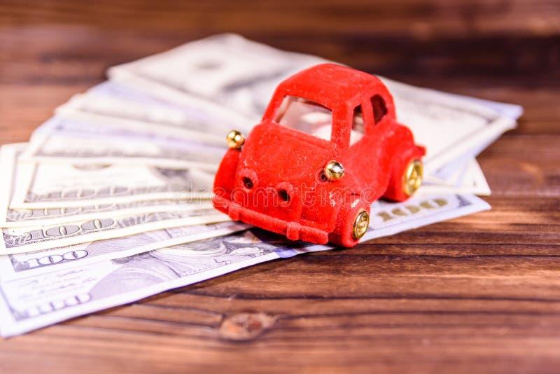 Toy car on a one hundred dollar bills. Toy car on one hundred dollar bills royalty free stock photo