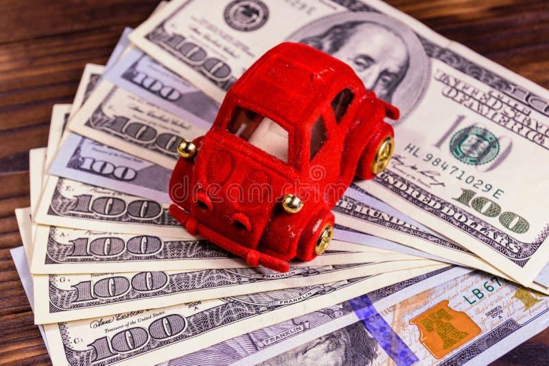 Toy car on a one hundred dollar bills. Toy car on one hundred dollar bills stock photos