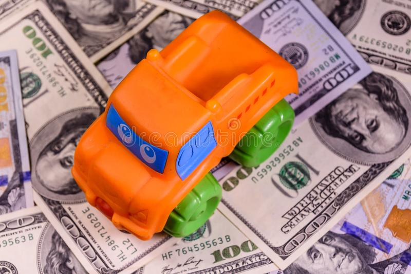 Toy car on a one hundred dollar bills. Toy car on one hundred dollar bills royalty free stock photo