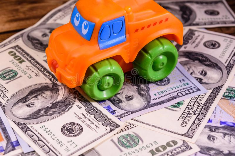 Toy car on a one hundred dollar bills. Toy car on one hundred dollar bills stock images