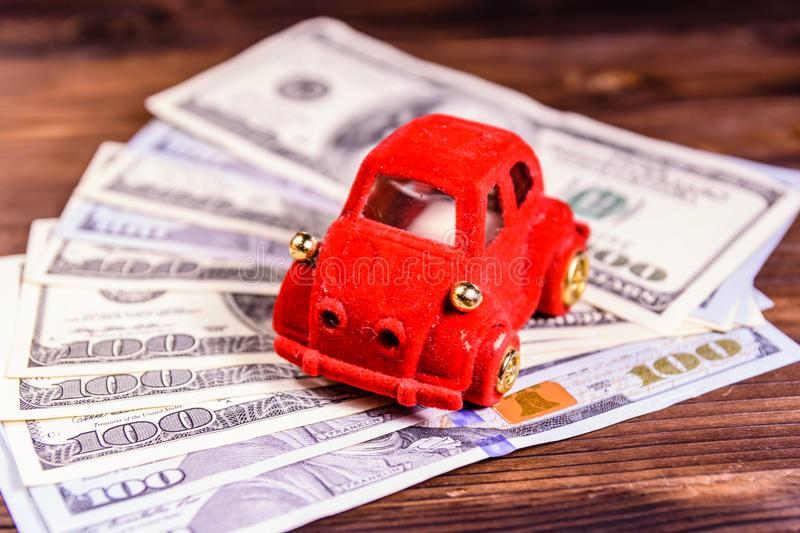 Toy car on a one hundred dollar bills. Toy car on one hundred dollar bills stock photo