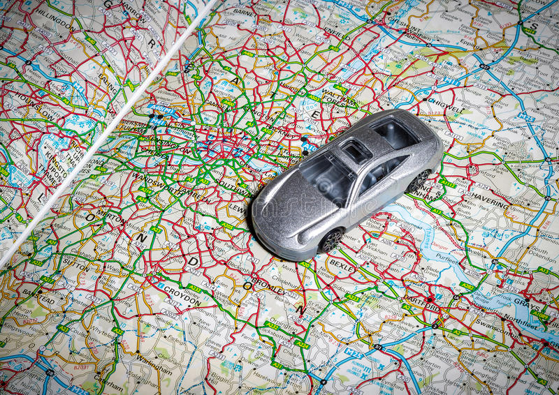 Toy car on road map stock image