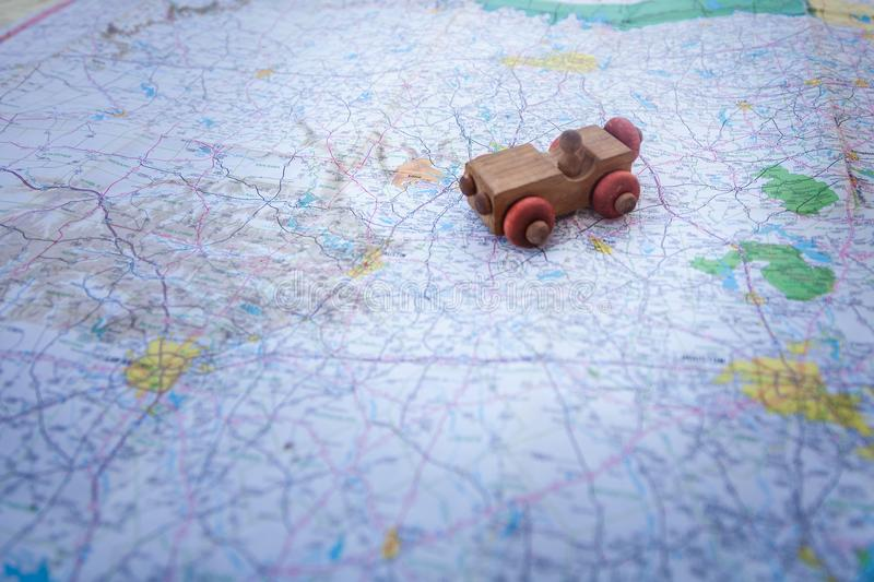 Toy car on a road map stock photography