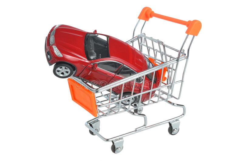 Toy car in shopping cart isolated on white stock photography