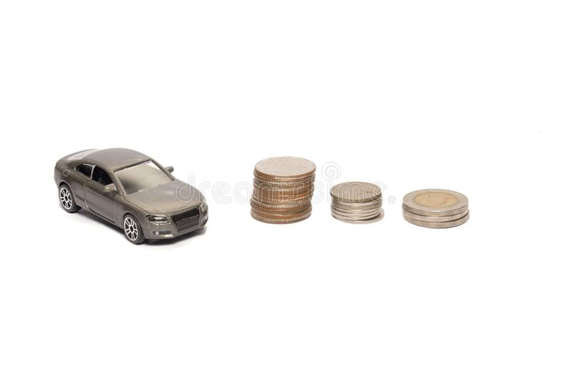 Toy car and stack of coin isolated on white. Background royalty free stock images