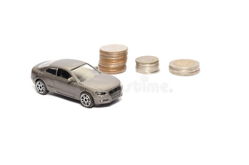 Toy car and stack of coin isolated on white. Background royalty free stock photography