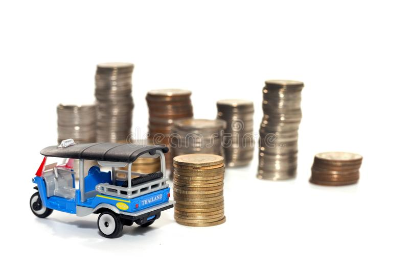 Toy car and stack of coin isolated on white. Background stock image