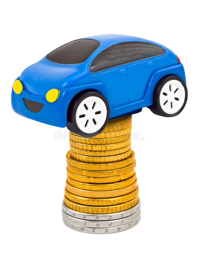 Toy car and stack of coins. Isolated on white background stock image