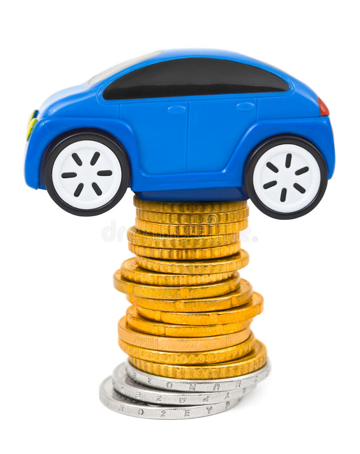 Toy car and stack of coins. Isolated on white background stock photography