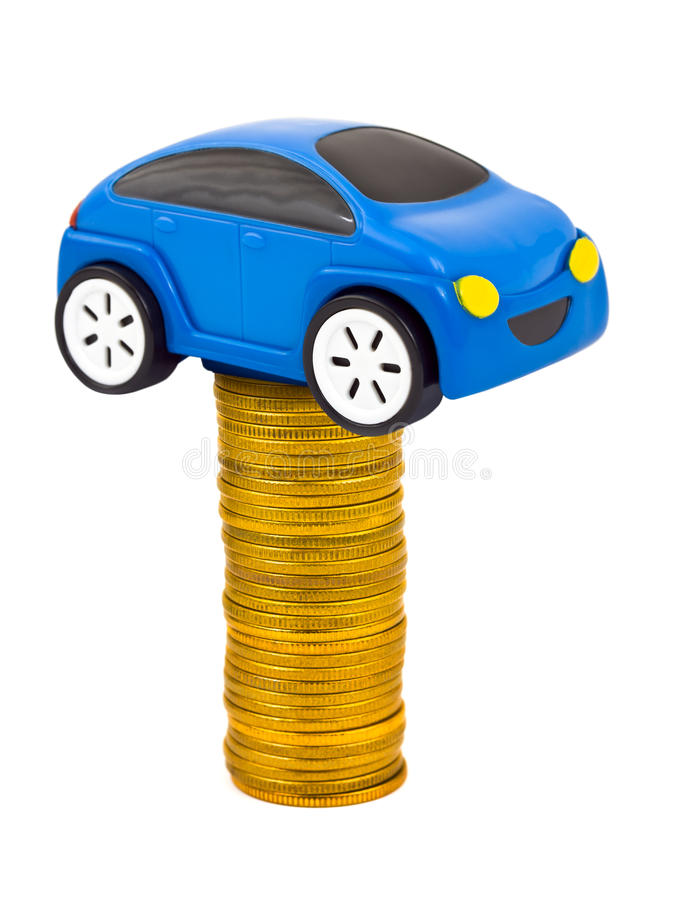 Toy car and stack of coins. Isolated on white background royalty free stock photo