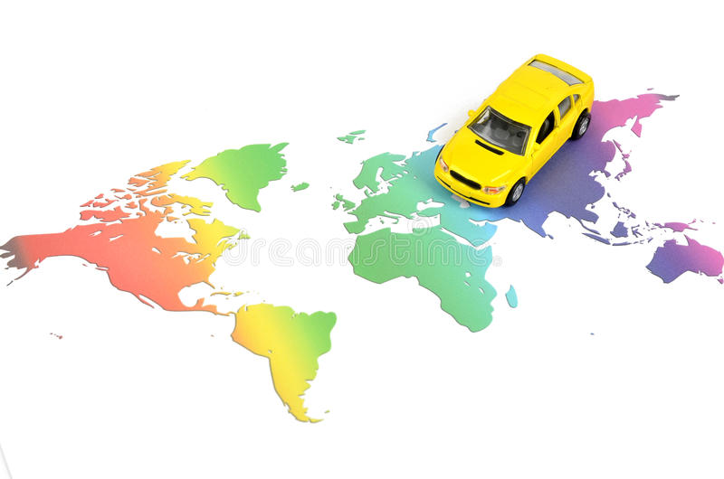 Toy car and world map stock photography