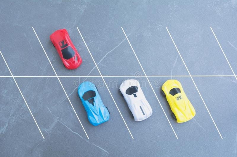 The toy cars parking in car park on background with copy space- royalty free stock image